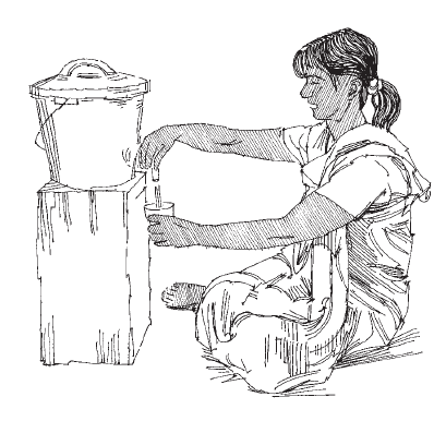 Woman sitting down and pouring a glass of water from a raised water container