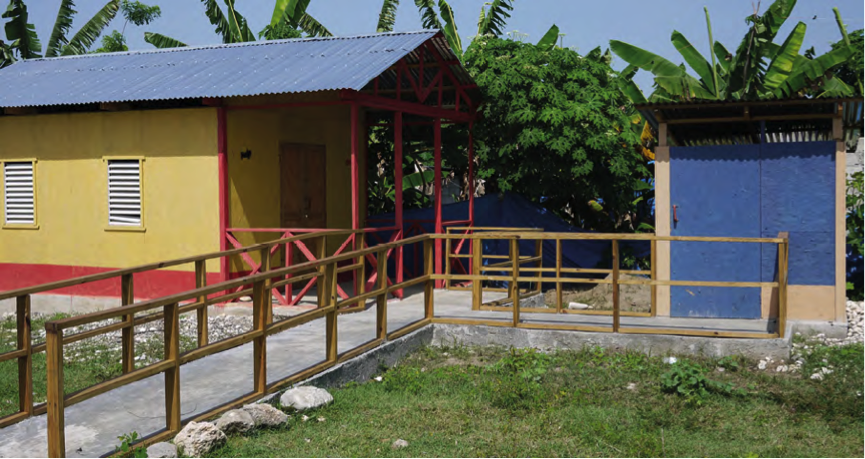 A shelter, accessed by a ramp and a washroom facility nearby