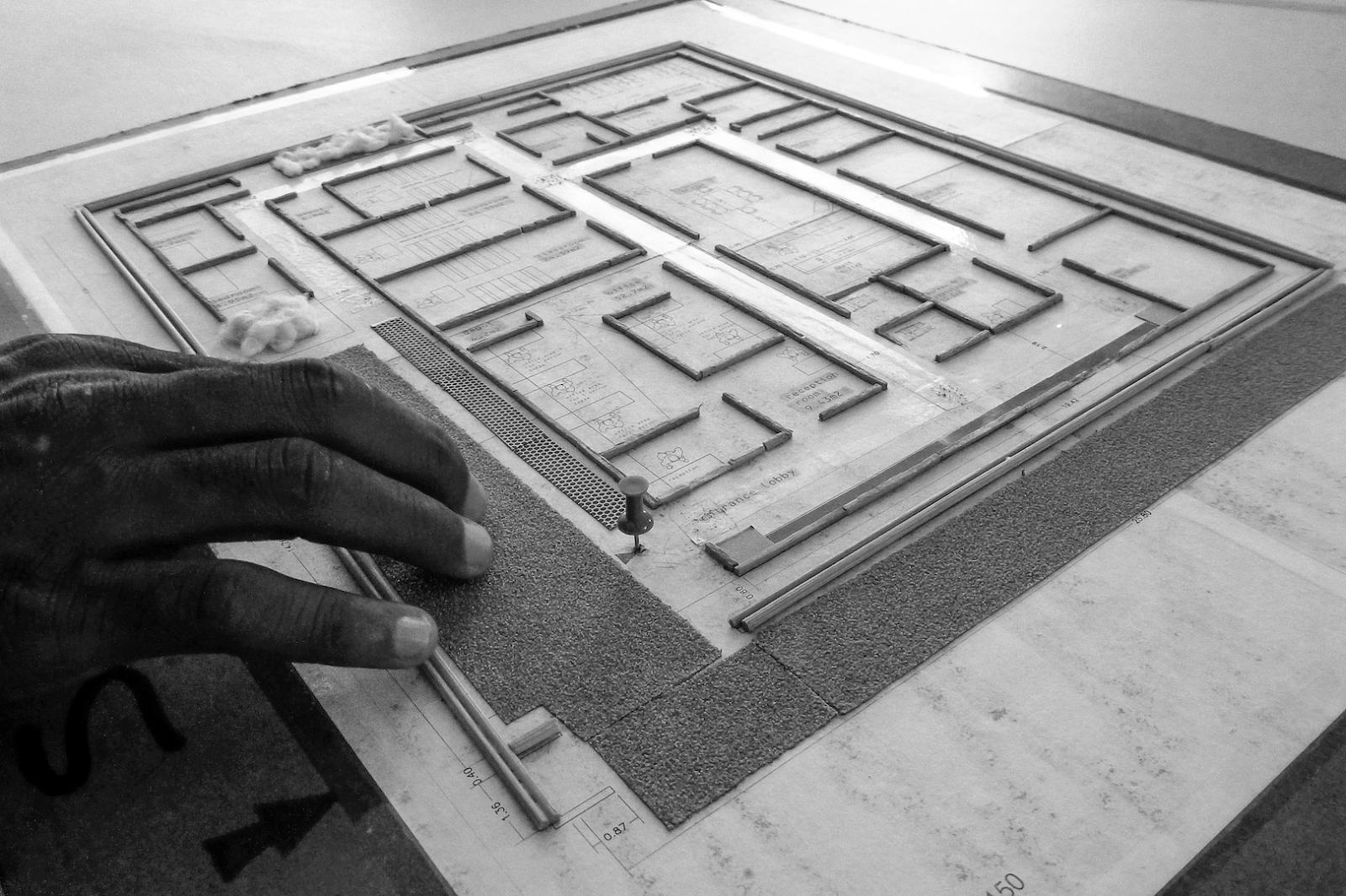 A person reading a tactile floor plan